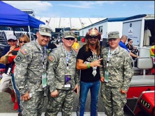 Military Support - Meeting with troops at a race event in 2017.